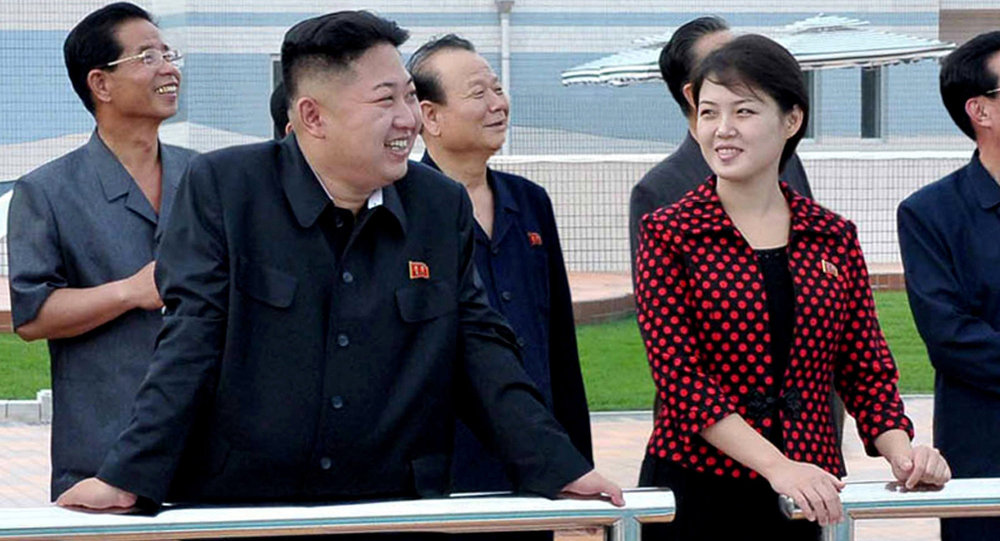 North Korean leader Kim Jong-un, front left, accompanied by his wife Ri Sol Ju, front right, inspects the Rungna People's Pleasure Ground in Pyongyang