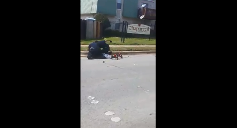 Video Shows Officer Punching Suspect