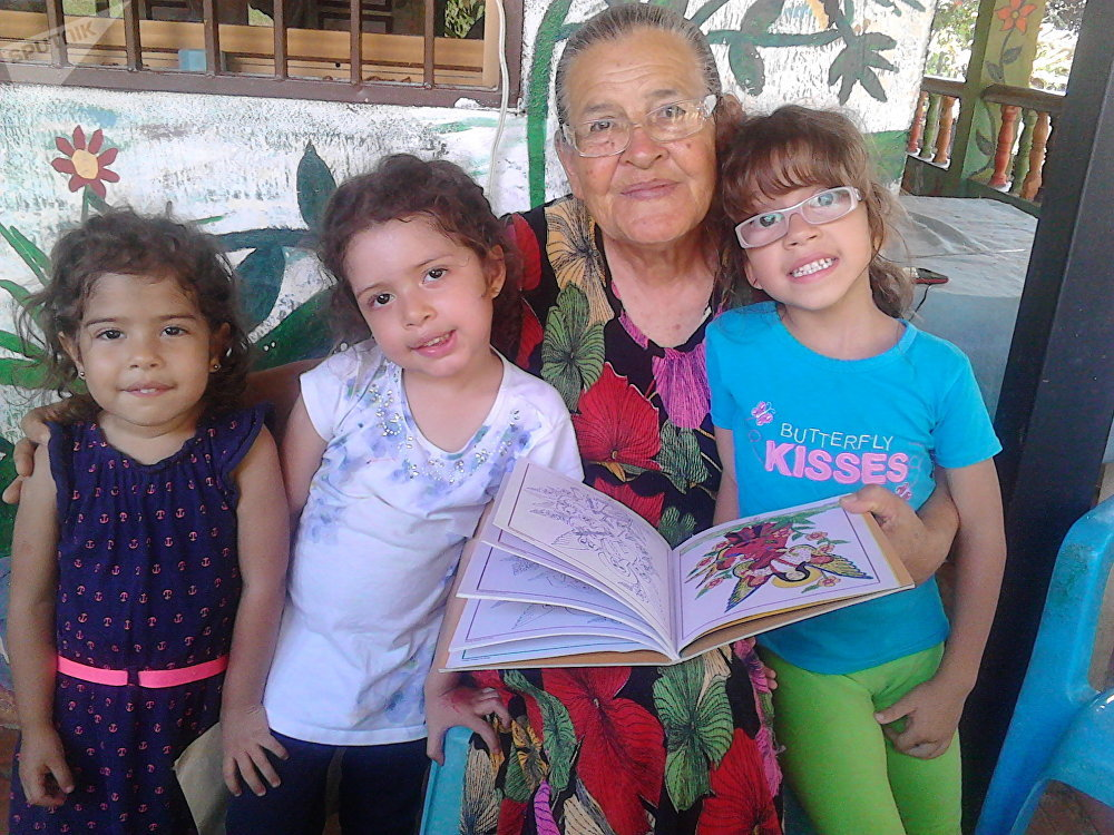 Rafaela Baroni together with kids , who come to see her daily