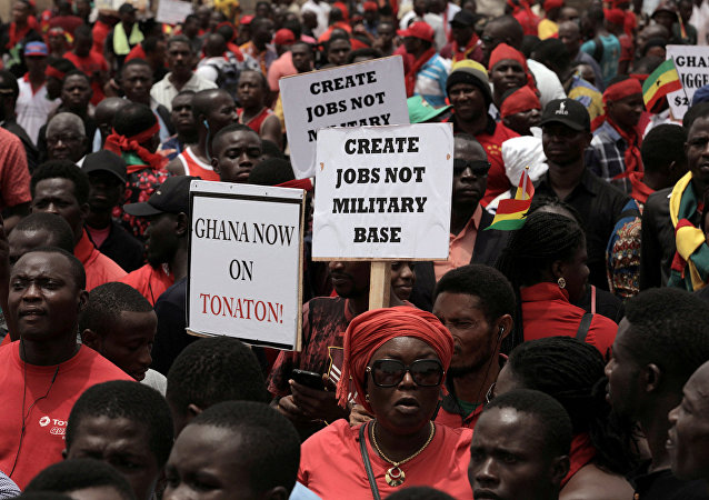 Demonstrators carry banners as they march during a protest in Ghana's capital Accra against the expansion of its defence cooperation with the United States, Ghana March 28, 2018.