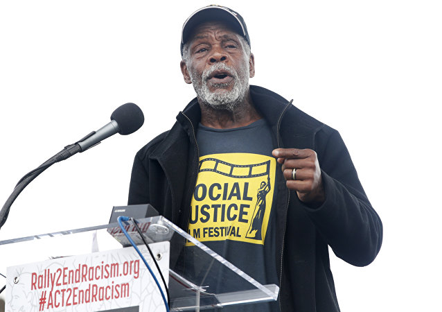 Actor Danny Glover speaks at the A.C.T. To End Racism rally, Wednesday, April 4, 2018, on the National Mall in Washington, on the 50th anniversary of Martin Luther King Jr.'s assassination.