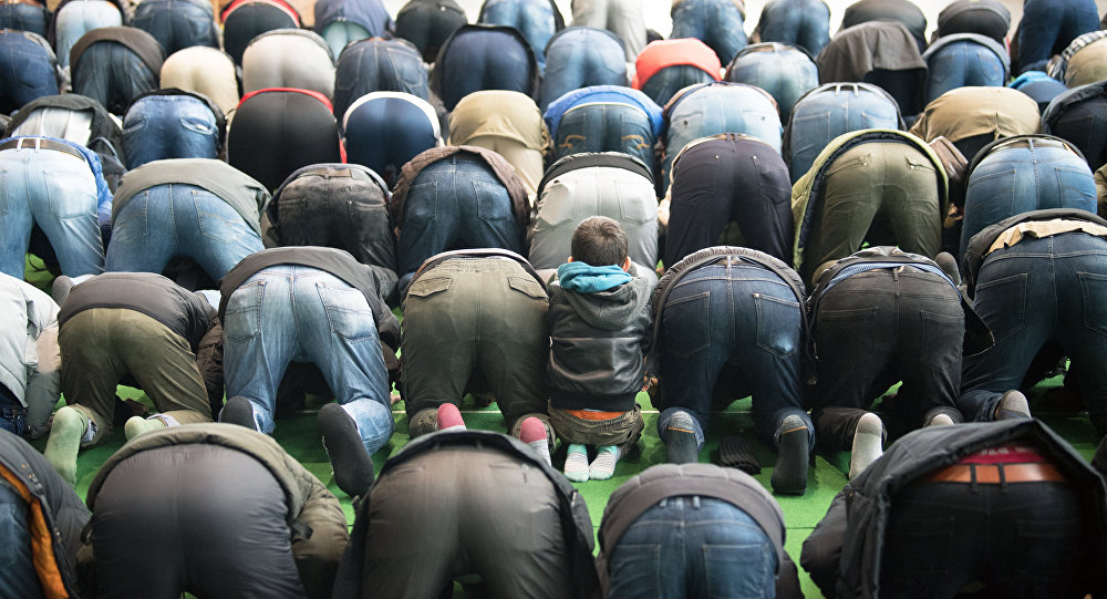 Muslims pray at a makeshift mosque in Potsdam near Berlin, northeastern Germany, on March 16, 2018
