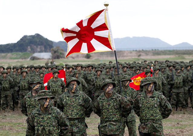 Soldiers of Japanese Ground Self-Defense Force (JGSDF)'s Amphibious Rapid Deployment Brigade, Japan's first marine unit since World War Two, gather at a ceremony activating the brigade at JGSDF's Camp Ainoura in Sasebo, on the southwest island of Kyushu, Japan April 7, 2018