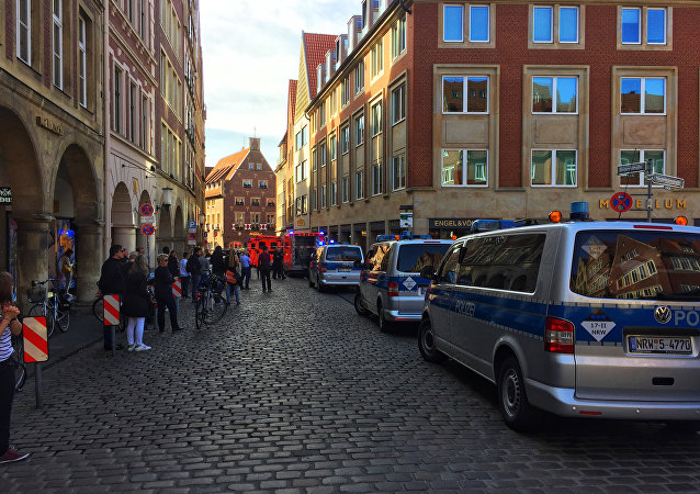 First responders work at the scene when several people were killed and injured when a car ploughed into pedestrians in Muenster, western Germany on April 7, 2018