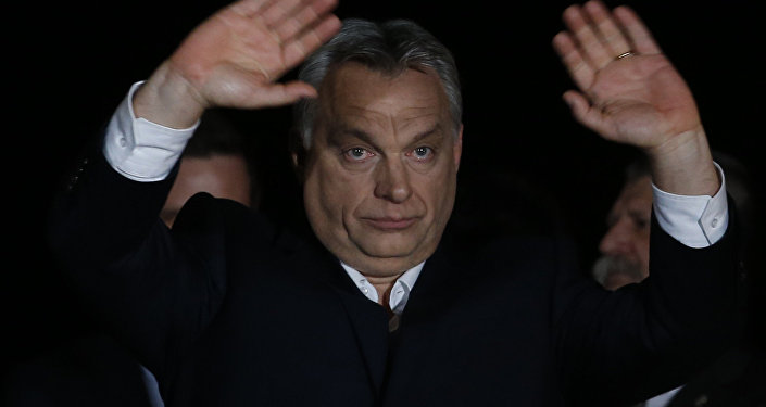 Hungarian Prime Minister Viktor Orban gestures in Budapest, Hungary, Sunday, April 8, 2018
