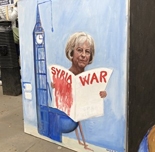 Live from Downing Street, London where crowds protest against Britain and the US launching military strikes in Syria.