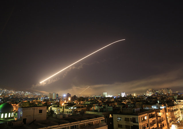 Damascus sky lights up with service to air missile fire as the U.S. launches an attack on Syria targeting different parts of the Syrian capital Damascus, Syria, early Saturday, April 14, 2018.