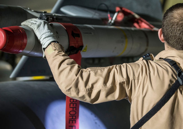 In this image released by Britain's Ministry of Defense, a Tornado pilot checks the weapons on his Tornado at Britain Royal Air Force base in Akrotiri, Cyprus, after its mission to conduct strikes in support of operations over the Middle East Saturday, April 14, 2018