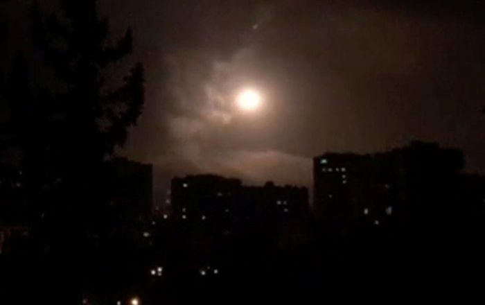 Syria air defences strike back after air strikes by U.S., British and French forces in Damascus, Syria in this still image obtained from video dated early April 14, 2018