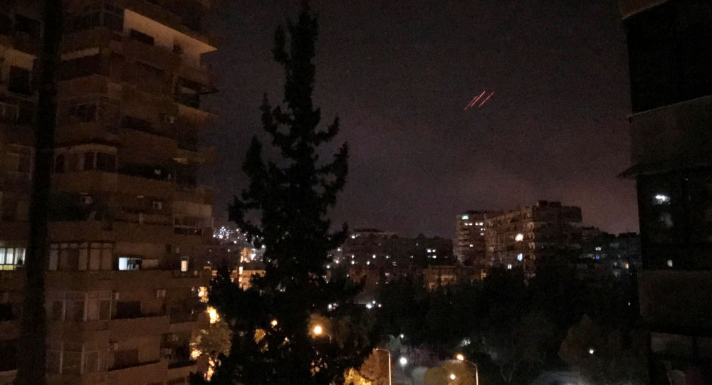 Anti-aircraft fire is seen over Damascus,Syria early April 14, 2018