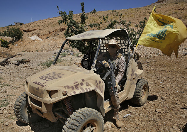 A Hezbollah fighters sits in a four-wheel motorcycle positioned at the site where clashes erupted between Hezbollah and al-Qaida-linked fighters in Wadi al-Kheil or al-Kheil Valley in the Lebanon-Syria border, Saturday, July 29, 2017