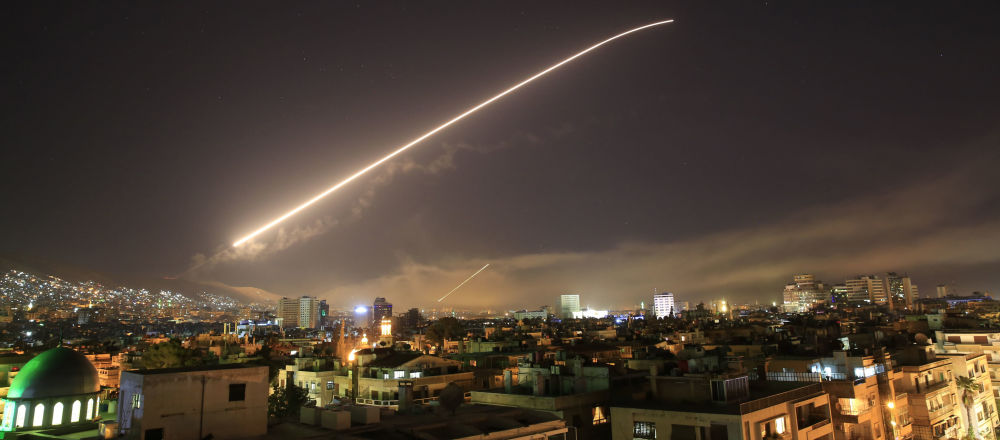 The Damascus sky lights up missile fire as the U.S. launches an attack on Syria targeting different parts of the capital early Saturday, April 14, 2018