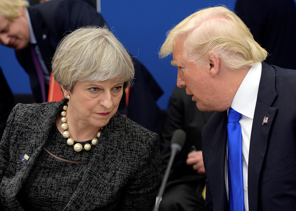 US President Donald Trump, right, speaks to British Prime Minister Theresa May in a working dinner meeting during the NATO summit of heads of state and government at the NATO headquarters, in Brussels on Thursday, May 25, 2017.