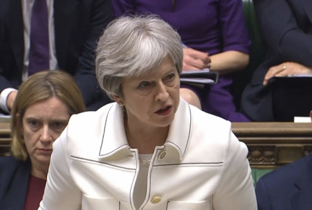 Britain's Prime Minister Theresa May makes a statement to MPs in the House of Commons in London, Monday April 16, 2018 over her decision to launch air strikes against Syria.
