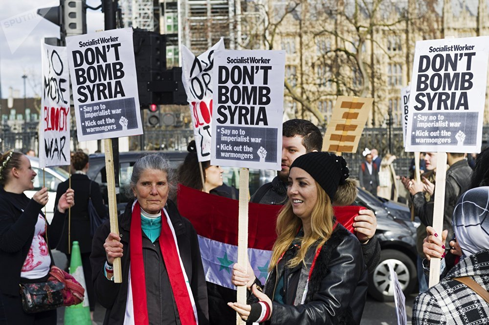 Participants in a protest in London against missile strikes on Syria
