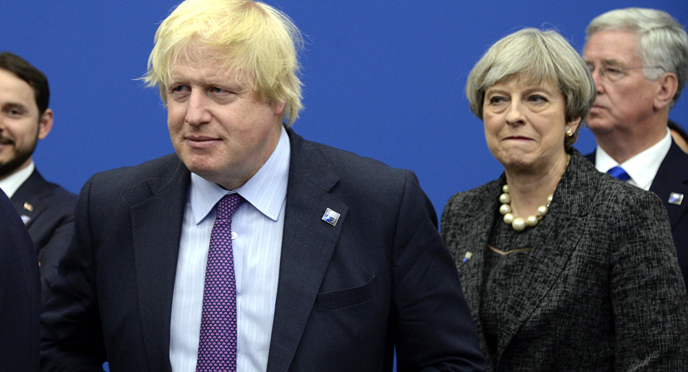 British Foreign Secretary Boris Johnson, left and Britain's Prime Minister Theresa May arrive for a meeting during the NATO summit of heads of state and government, at the NATO headquarters, in Brussels on Thursday, May 25, 2017