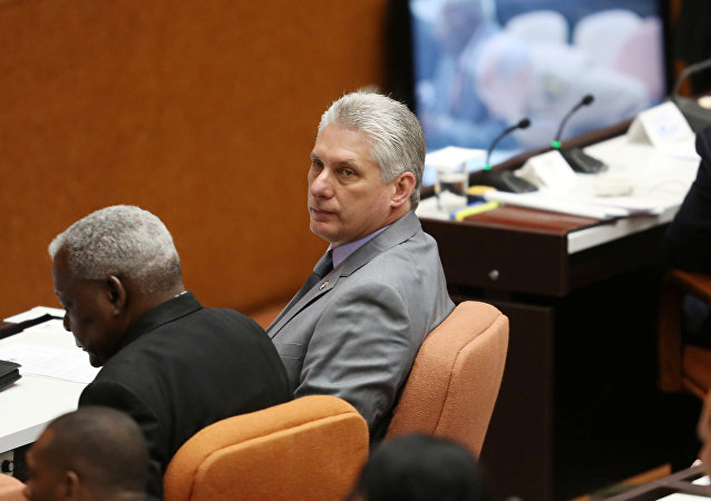 Cuba's First Vice-President Miguel Diaz-Canel (C) takes part in a session of the National Assembly in Havana, Cuba