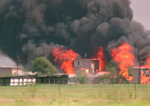 In this April 19, 1993 file photo, flames engulf the Branch Davidian compound in Waco, Texas