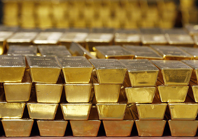 In this Tuesday, July 22, 2014, file photo, gold bars are stacked in a vault at the United States Mint, in West Point, N.Y.