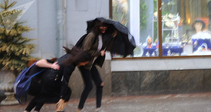 Pedestrians at streets of Moscow during the storm