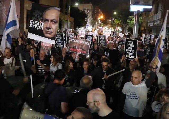 Thousands rally in Tel Aviv to protect Israel from turning into 'Netanyahu state'
