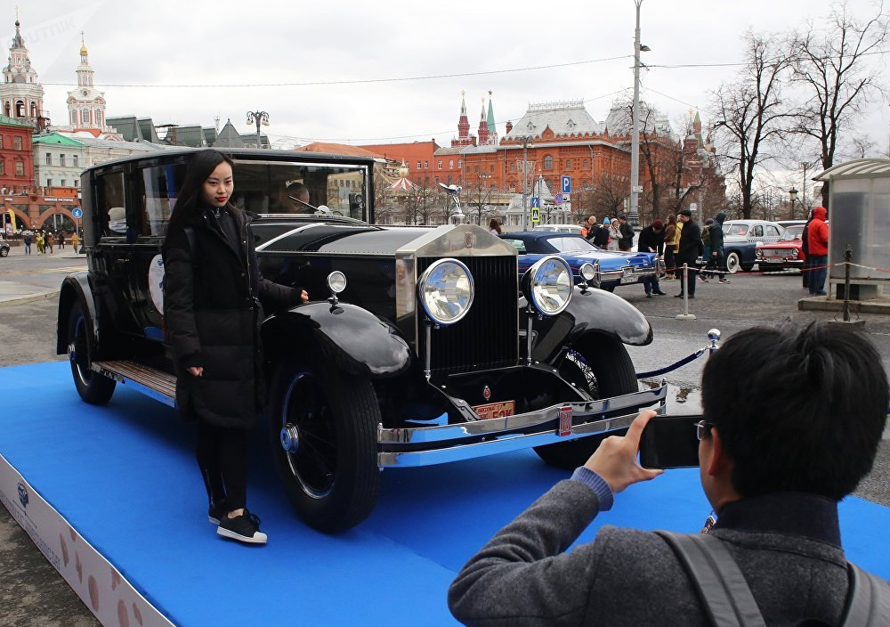 Visitors Taking Pictures with Car Participating in 'Ingosstrakh Exclusive Classic Day'