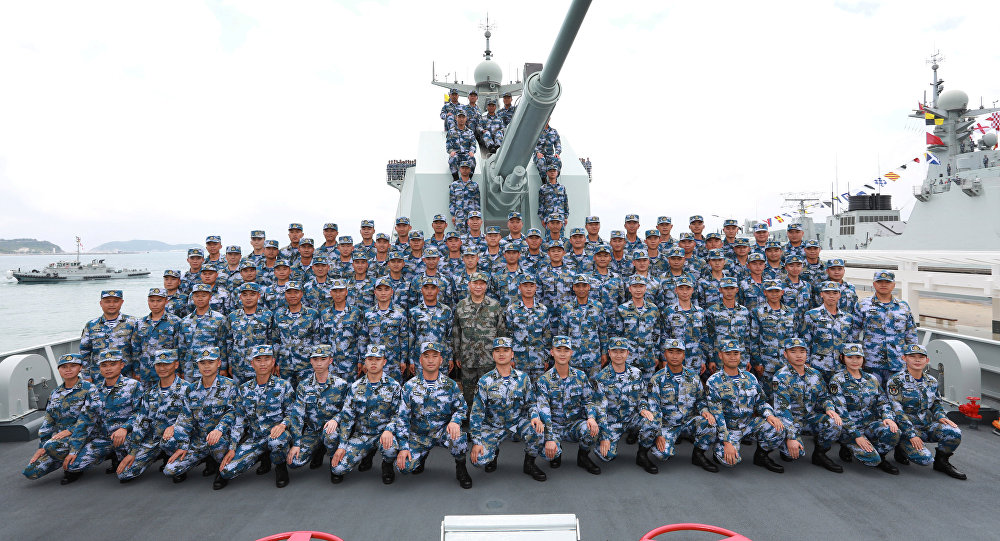 Chinese President Xi Jinping poses for a group photo on the destroyer Changsha as he reviews a military display of Chinese People's Liberation Army (PLA) Navy in the South China Sea April 12, 2018