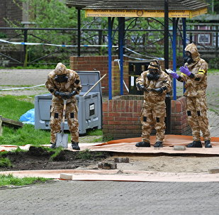 Military personnel dig near the area where former Russian intelligence officer Sergei Skripal and his daughter Yulia were found on a park bench in the UK's Salisbury. File photo