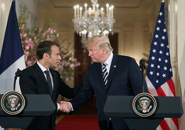US President Donald Trump and French President Emmanuel Macron shake hands before holding a joint press conference at the White House in Washington, DC, on April 24, 2018