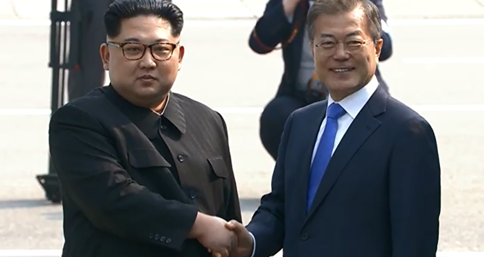 North Korea's Kim Jong Un shakes hands with South Korea's Moon Jae In during historic summit meeting