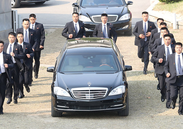 Security personnel accompany a vehicle transporting North Korean leader Kim Jong Un at the truce village of Panmunjom inside the demilitarized zone separating the two Koreas, South Korea, April 27, 2018