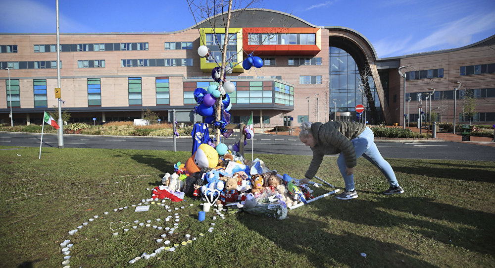 A woman leaves a soft toy outside Alder Hey Children's Hospital in Liverpool, England, following the death of 23-month-old, Alfie Evans, Saturday April 28, 2018