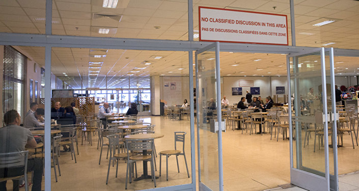 People dine in the cafeteria section at the old NATO headquarters in Brussels on Thursday, April 19, 2018