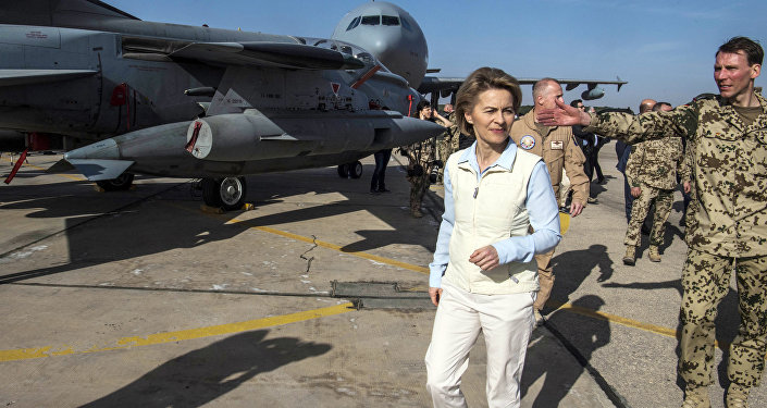 German Defence Minister Ursula von der Leyen, left, inspects a German air force aircraft as she visits the German contingent at the Al Azraq air base in Jordan, Saturday, Jan. 13, 2018