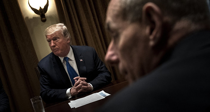 US President Donald Trump (L) and White House Chief of Staff John Kelly wait for a meeting with lawmakers in the Cabinet Room of the White House on September 13, 2017 in Washington, DC.