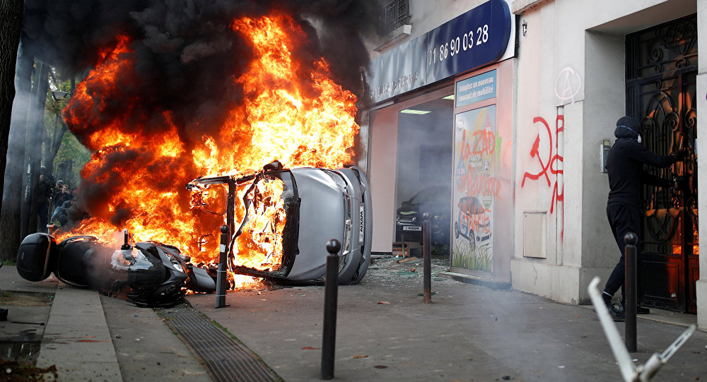 Police arrest 200 people in Paris as protesters petrol-bomb McDonald's