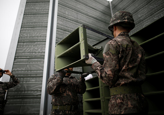 South Korean soldiers dismantle loudspeakers that were set up for propaganda broadcasts near the demilitarized zone separating the two Koreas in Paju, South Korea, May 1, 2018.