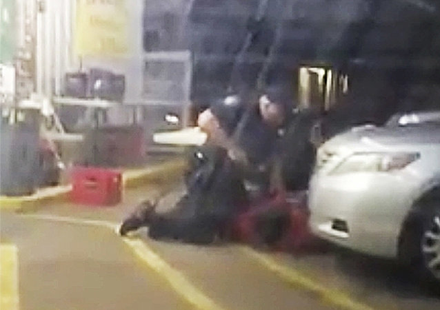 Former Baton Rouge officer Blane Salamoni holds a gun to Alton Sterling at point-blank range.