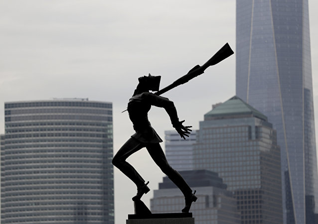 Buildings in Lower Manhattan provide a backdrop to a statue dedicated to the victims of the Katyn massacre of 1940, Friday, May 4, 2018, in Jersey City, N.J.