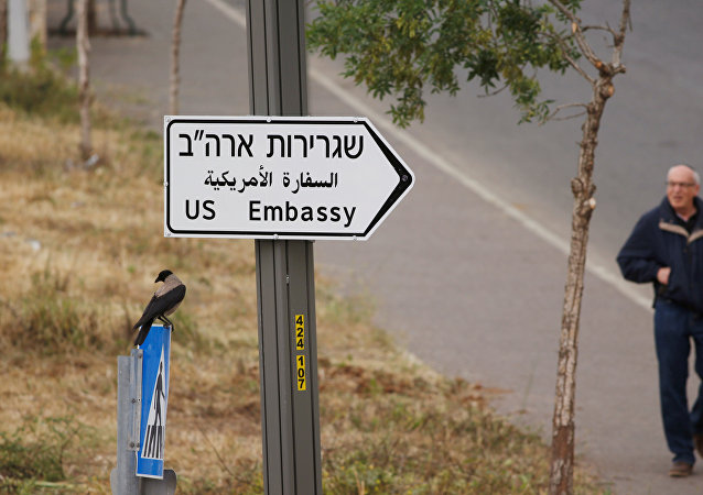 A man walks next to a road sign directing to the U.S. embassy, in the area of the U.S. consulate in Jerusalem, May 7, 2018
