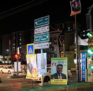 Campaign posters of a candidate are seen ahead of parliamentary election, in Erbil, Iraq, April 26, 2018