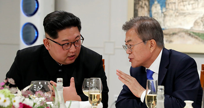 South Korean President Moon Jae-in and North Korean leader Kim Jong Un attend a banquet on the Peace House at the truce village of Panmunjom inside the demilitarized zone separating the two Koreas, South Korea, April 27, 2018