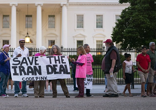 Members of Code Pink rally in support of Iran's nuclear deal with world powers in front of the White House in Washington, Monday, May 7, 2018