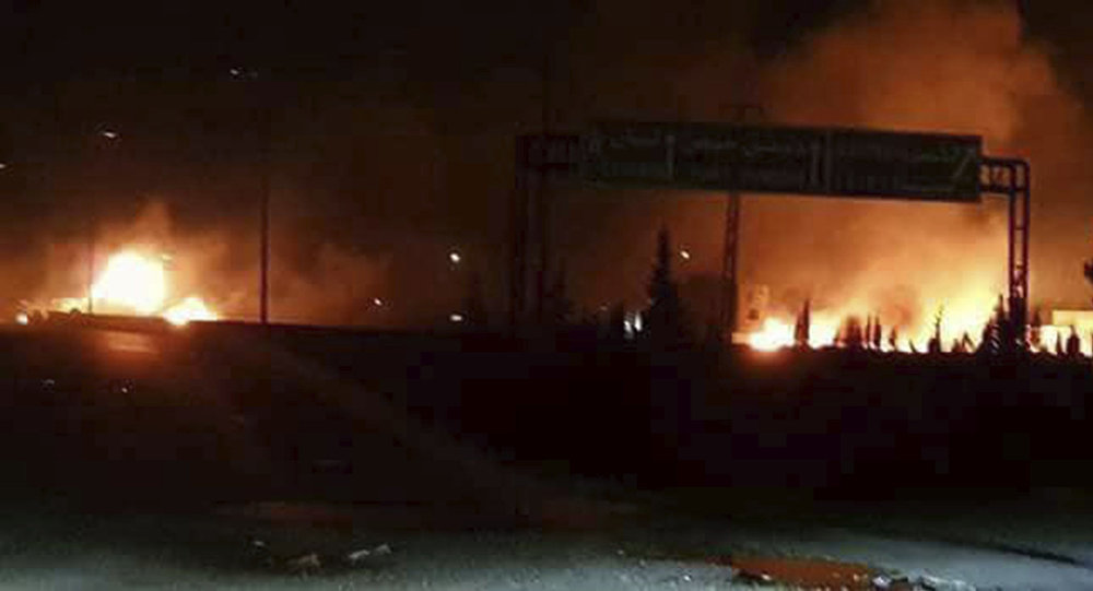 This photo released on Wednesday, May 9, 2018, by the Syrian official news agency SANA, shows flames rising after an attack in an area known to have numerous Syrian army military bases, in Kisweh, south of Damascus, Syria