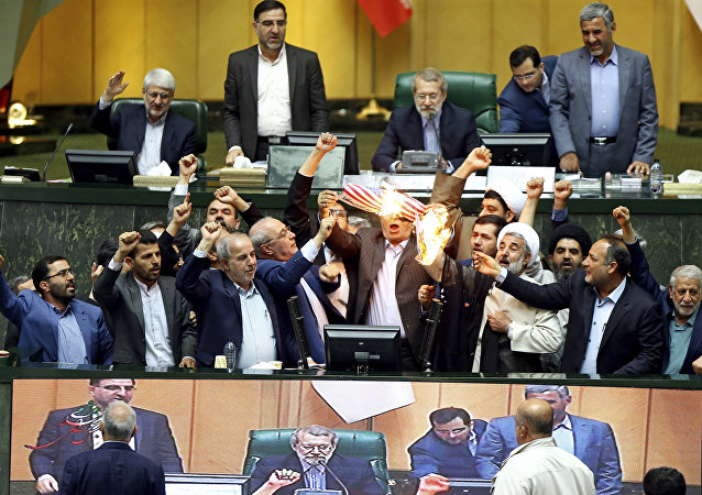 Iranian lawmakers set fire on JCPOA, US flag after Trump's exit from Iran deal