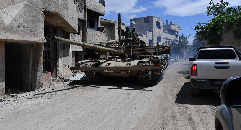 A T-55 tank in the area of the former Palestinian refugee camp Yarmouk in the southern suburb of Damascus