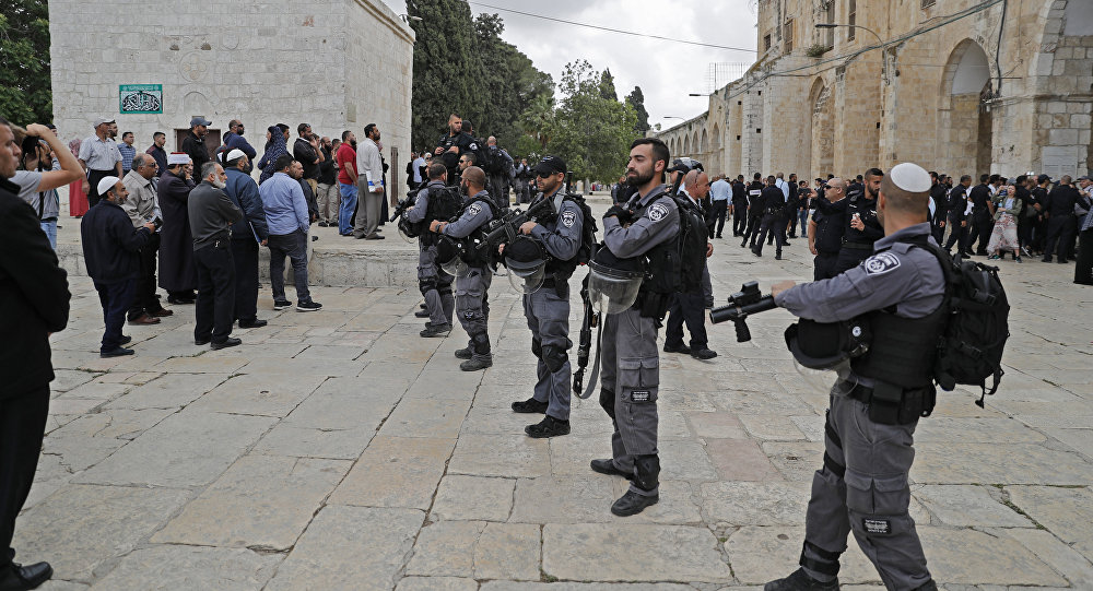 Israeli security forces stand guard at Al-Aqsa mosque compound in Jerusalem's Old City on May 13, 2018