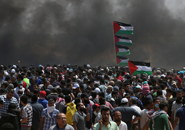Palestinian demonstrators gather during a protest against U.S. embassy move to Jerusalem and ahead of the 70th anniversary of Nakba, at the Israel-Gaza border in the southern Gaza Strip May 14, 2018