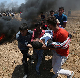 A wounded Palestinian demonstrator is evacuated during a protest against U.S. embassy move to Jerusalem and ahead of the 70th anniversary of Nakba, at the Israel-Gaza border in the southern Gaza Strip May 14, 2018
