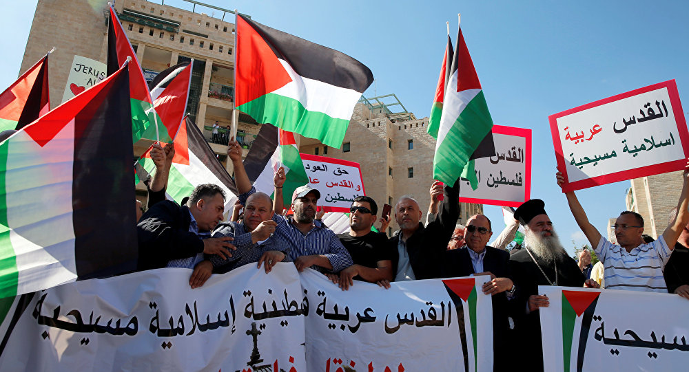 Palestinians, among them Adnan Husseini (3-rd R), the Palestinian Authority-appointed mayor of Jerusalem, participate in protest against the opening of the new U.S. embassy in Jerusalem, in Jerusalem May 14, 2018. Banner reads in Arabic Jerusalem Arab, Palestinian, Islamic and Christian and No to the Moving of the American Embassy.
